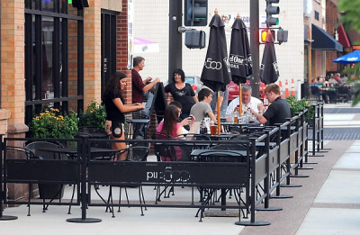 """""""Pub 500 added 15 tables of seating in a new patio expansion. Owner Tom Frederick welcomes the added police presence downtown. Photo by Pat Christman"""""""