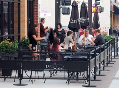 """Pub 500 added 15 tables of seating in a new patio expansion. Owner Tom Frederick welcomes the added police presence downtown. Photo by Pat Christman"""